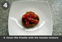 Cover the friselle with the tomato mixture.