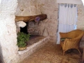 Trullo Le 300 Fronde fire place